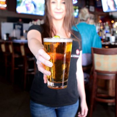 K O'Donnell's Sports Bar & Grill Waitress Holding Beer